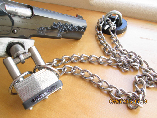 14 - US patent 9,603,446  		Security Anchor locking to Colt .45 using my US patent 8,640,507 Horizontal Shackle For Lock System and Method and my US Patent 8,640,511 Low Profile Lock Interface System and Method 		and a Clicksafe though could be a Microsaver, Nanosaver or a padlock.